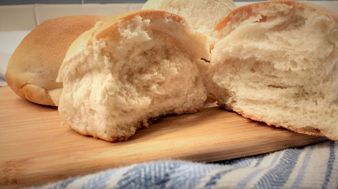 Learn how to make basic bread rolls with a simple ingredient list and step by step instructions