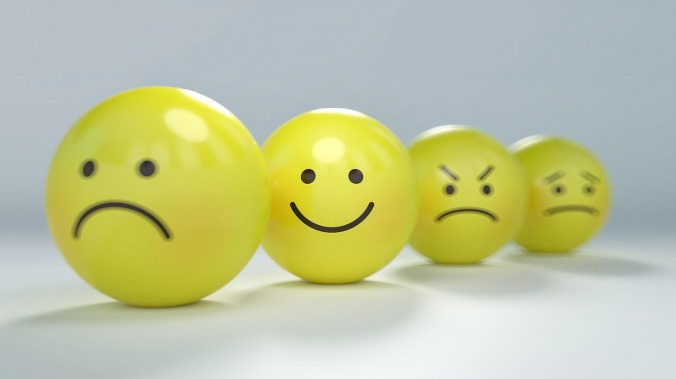 Feelings emoticon buttons, one smiling