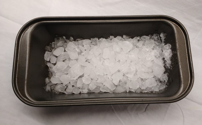 Using ice chips in a hot tin or skillet helps create stems in the oven, which helps to create a good bread crust.