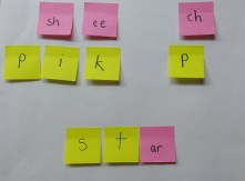 Write sounds on sticky notes and use them to make words.